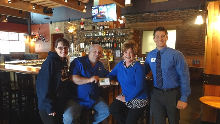 Gabby's Grill owners Kelley and Jim Cabral with Chamber CEO/President Marnie Uhl and Membership Services Director Zack Hurt.
