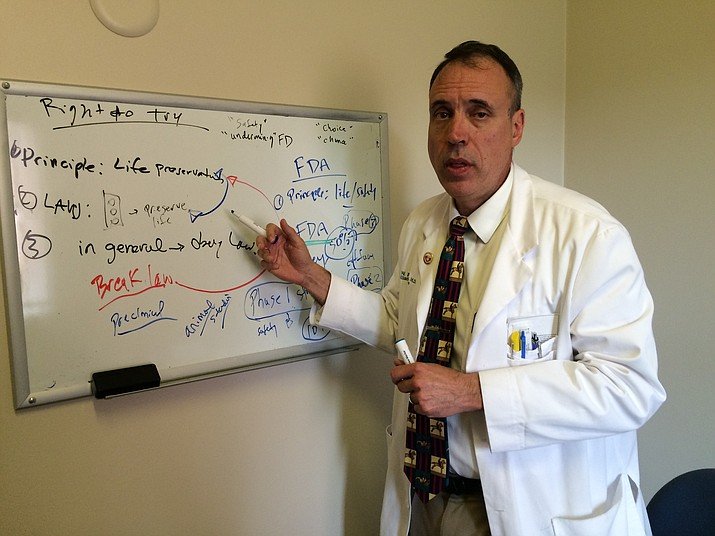 Dr. Larry Parsons, Yavapai Regional Medical Center's director of inpatient palliative care medicine, diagrams how Right-to-Try laws work.