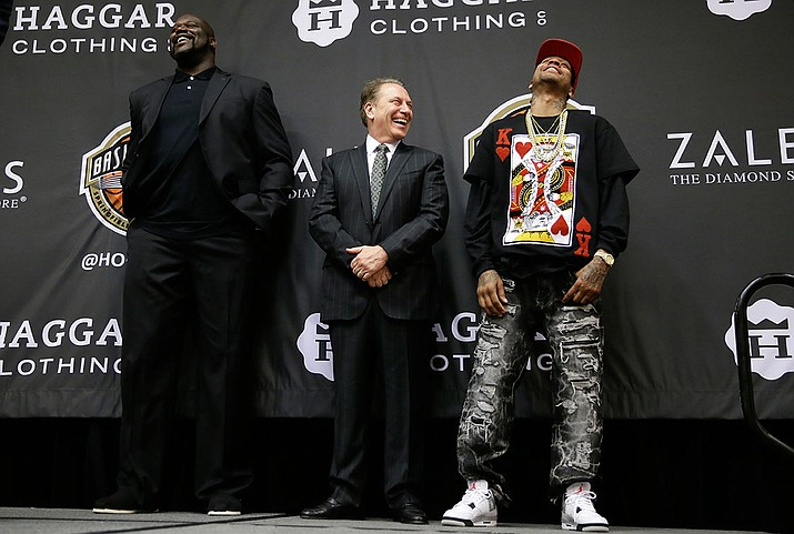 Retired NBA player Shaquille O'Neal, left, Michigan State head coach Tom Izzo, center, and retired NBA player Allen Iverson laugh on stage during the Naismith Memorial Basketball Hall of Fame Class of 2016 announcement, Monday, April 4, in Houston.