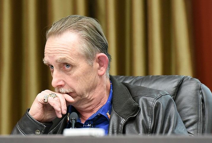 Prescott City Council member Jim Lamerson listens to Prescott Fire Chief Dennis Light talk about the current short staffing problems the department is having Tuesday night during a city council meeting April 5, 2016 at City Hall in Prescott.  (Matt Hinshaw/The Daily Courier)