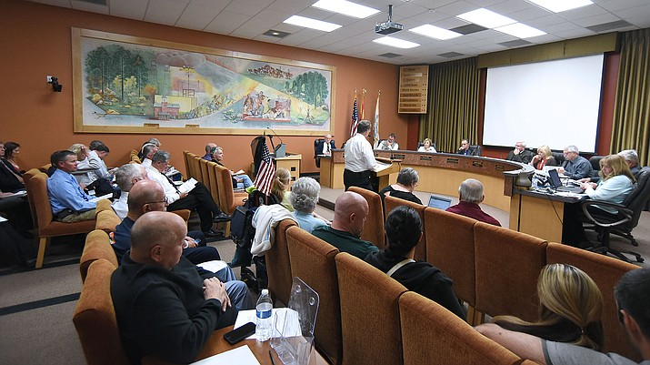 People fill Prescott City Hall to give their comments about the Prescott Fire and Police Department budgets and staffing Tuesday night April 5, 2016 during a city council meeting at City Hall in Prescott. Public comment was pushed to a future meeting by Mayor Harry Oberg. (Matt Hinshaw/The Daily Courier)