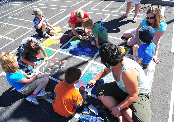 A group of children and adults try their hand at Chalking it Up at the 2012 Prescott Chalk It Up! event in downtown Prescott.
