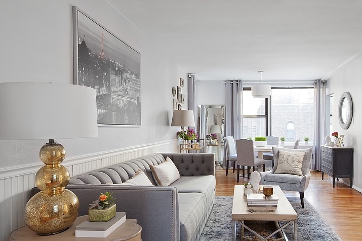 In this photo provided by Decor Aid, co-founder and designer Sean Juneja used home design blogs and other online resources to help design a clutter-free, serene retreat from the bright lights and busy streets of New York City in a high-rise apartment on the Upper East Side.