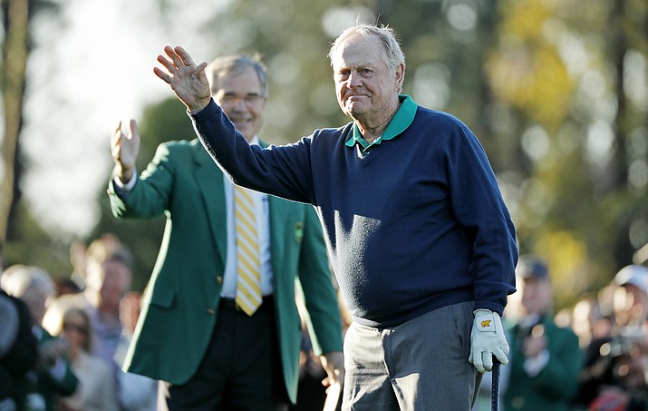 Jack Nicklaus waves before hitting a ceremonial first tee before the first round of the Masters golf tournament Thursday, April 7, in Augusta, Ga. Behind his Billy Payne, CEO and Chairman of Augusta National Golf Course. (Matt Slocum/Associated Press)