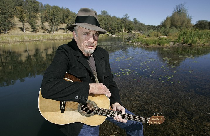 In this Oct. 2, 2007 file photo, Merle Haggard poses at his ranch at Palo Cedro, Calif. Haggard died of pneumonia, Wednesday, April 6, 2016, in Palo Cedro, Calif. He was 79.