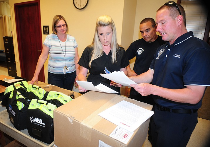 Central Arizona Fire and Medical Authority firefighter Erik Trujillo and Captain Doug Niemynski deliver five automatic external defibrillator's (AED) to Humboldt Unified School District nurse Amy Stooks and secretary Shannon Chaney Wednesday afternoon. The district ordered the AED's through the fire authority and saved close to $6,000 for the devices and training. The fire authority will provide initial training in the AED use and CPR to district employees free of charge. The five AED's will now ensure all district building will have one on-site. (Les Stukenberg/The Daily Courier)