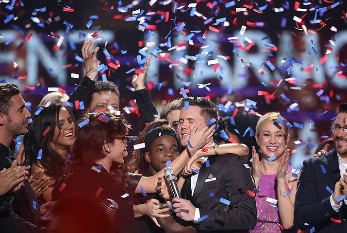 "Trent Harmon, center, winner of ""American Idol"" The Farewell Season celebrates with fellow contestants during the season finale at the Dolby Theatre on Thursday, April 7, in Los Angeles."