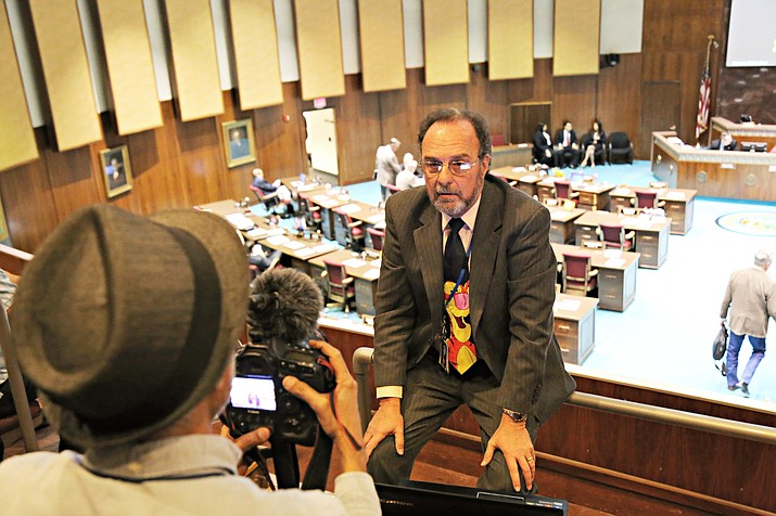 Arizona Republic photographer Nick Oza interviews Capitol Media Services reporter Howard Fischer about the Arizona House of Representatives denying reporters access to the floor pending criminal and civil background checks, in Phoenix Thursday.