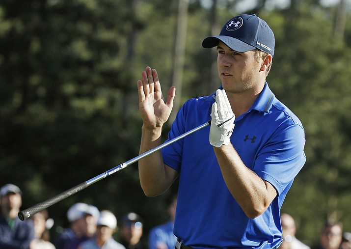 Jordan Spieth indicates how far he miss a putt for par on the 17th green on the during the second round of the Masters golf tournament Friday in Augusta, Ga.