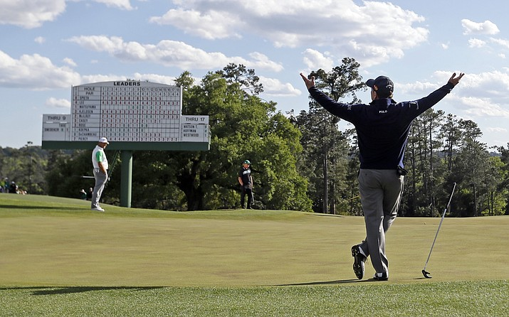 Tom Watson reacts after a long putt on the 18th hole playing his last round at the Masters golf tournament Friday, April 8, 2016, in Augusta, Ga. Jordan Spieth still holds a lead through Saturday with a 3-under par 213.