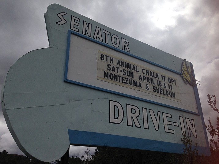 The historic Senator Drive-In sign advertises downtown Prescott's big chalk art festival, Chalk It Up!