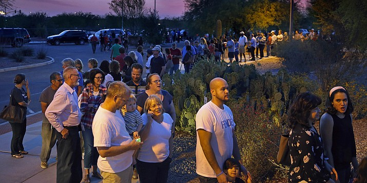 People wait in line to vote in the primary Tuesday, March 22, 2016, in Chandler, Ariz. A document obtained from the Maricopa County Recorder's Office shows that five polling places in metro Phoenix still had voters in line after midnight during Arizona's botched presidential primary two weeks ago, including one location where the final ballot was cast at nearly 1 a.m., according to county records.