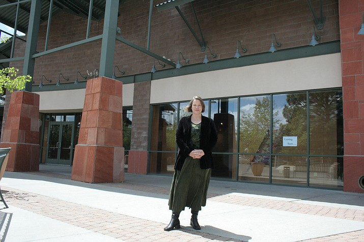 Julie Adams, owner of Miller Valley Indoor Art Market, stands in front of her store's soon-to-be location at the Prescott Gateway Mall. She's renaming the business Prescott Art Market and hopes to have it open by June 1.
