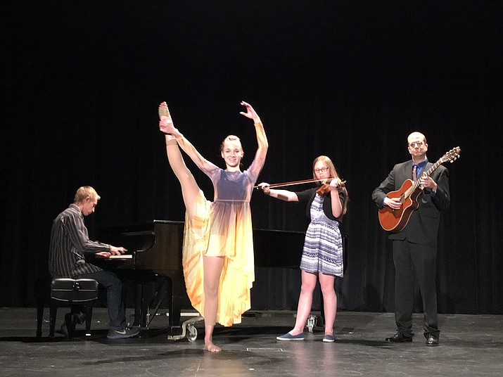 From left to right, Corey Cline (piano), Tayhlar Tenney (dancer), Madeleine Cherry (Violin) and Mr. Dave Stengel (History teacher & co-adviser NHS).