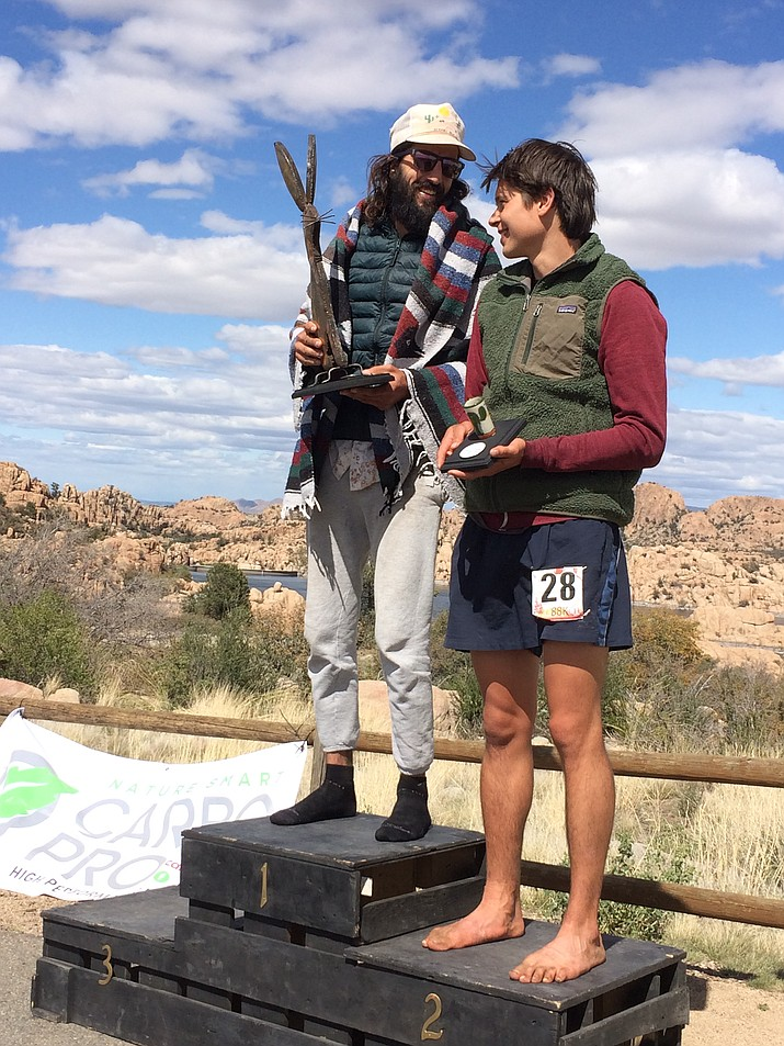 Michael Versteeg of Prescott, left, won the 88K Ultra Men's race at the inaugural Whiskey Basin Trail Runs on Saturday at the Prescott Circle Trail in Prescott. His time was 8 hours and 34 minutes. Nick Treinen of Alaska placed second in 9:06:00. Scott Vig, not pictured, took third in 9:11:00.