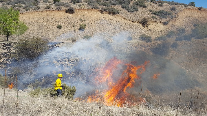 A firefighter works to put out a small brush fire along Highway 69 Monday morning, April 18. A spokesman said it wa started by a campfire that was not put out.