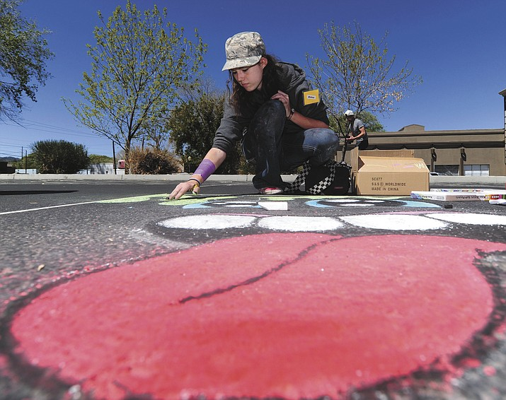 Youth featured artist Melissa White at the Chalk it Up event on the National Bank parking lot in downtown Prescott Saturday morning.