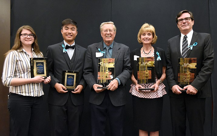 The winners for the Prescott Area Leadership Man, Woman, and Youth Leaders of the Year, from left, Sydney Sundell, Brandon Nguyen, Mayor Harvey Skoog, Lynda Kieckhefer, and Mike Fann gather for a group photo Wednesday night at the Prescott Resort.
