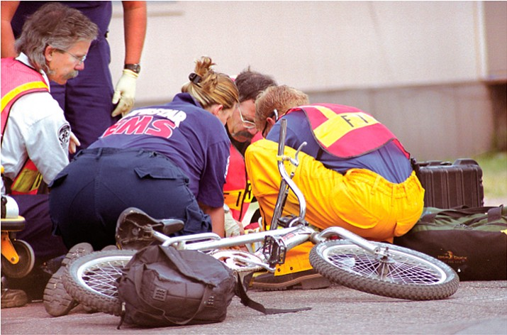 This is the scene of another accident I witnessed a few years ago when a child was hit by a car. As a parent, it's hard not to imagine your own child's bike on the ground as emergency workers gather around a young and frightened face.