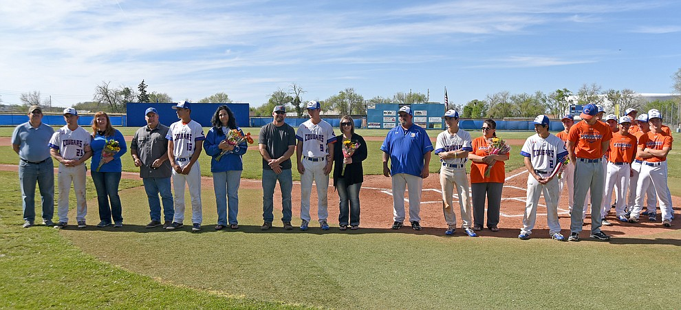 From right, Chino Valley baseball team seniors Manager Garrett King, Israel Acosta, Trevor Drake, Jake Clawson, Jared Tippit, and Spencer Coffin gather for a photo with their family, friends, and teammates before their final regular season home game against Mohave Tuesday afternoon April 19, 2016 at Chino Valley High School. (Matt Hinshaw/The Daily Courier)