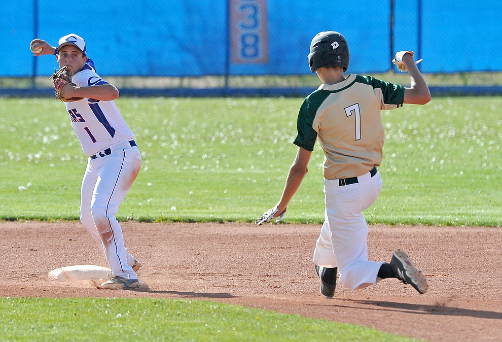 Chino Valley's Skylar Brooks (1) turns a double play while Mohave's Bjorn Syme (7) slides into second base Tuesday afternoon April 19, 2016 during Chino's last regular season home game at Chino Valley High School. (Matt Hinshaw/The Daily Courier)