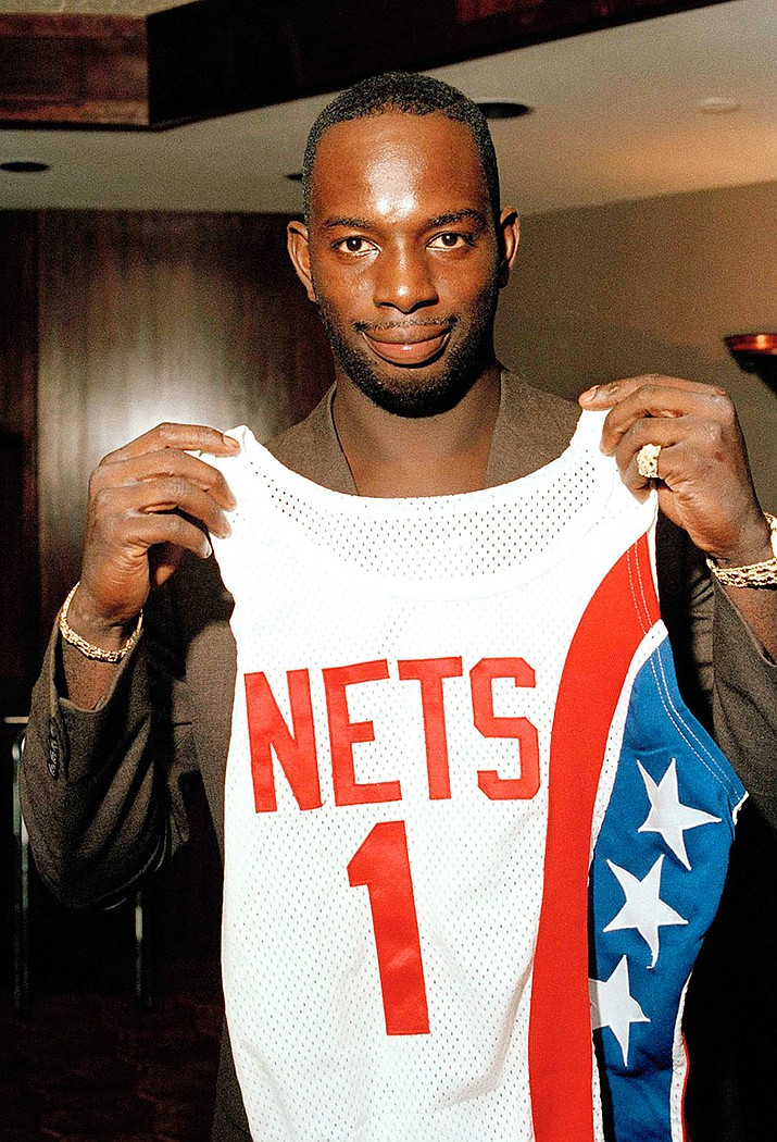 "In this Aug. 20, 1986 file photo, Dwayne ""Pearl"" Washington, the first draft pick by the New Jersey Nets, holds up his new uniform during a press luncheon at the Meadowlands Arena in East Rutherford, N.J.  Washington, who went from New York City playground wonder to Big East star for Jim Boeheim at Syracuse, has died. He was 52. Washington died Wednesday, April 20, 2016, of cancer, the university said."
