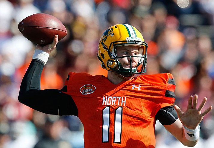North Dakota State quarterback Carson Wentz throws a pass during the 2016 Senior Bowl at Ladd–Peebles Stadium in Mobile, Ala. The Philadelphia Eagles in Wednesday acquired the No. 2 overall pick in next week's draft from the Cleveland Browns in exchange for five picks. The trade allows Philadelphia to select one of the top quarterback prospects, likely Wentz or Jared Goff of California.