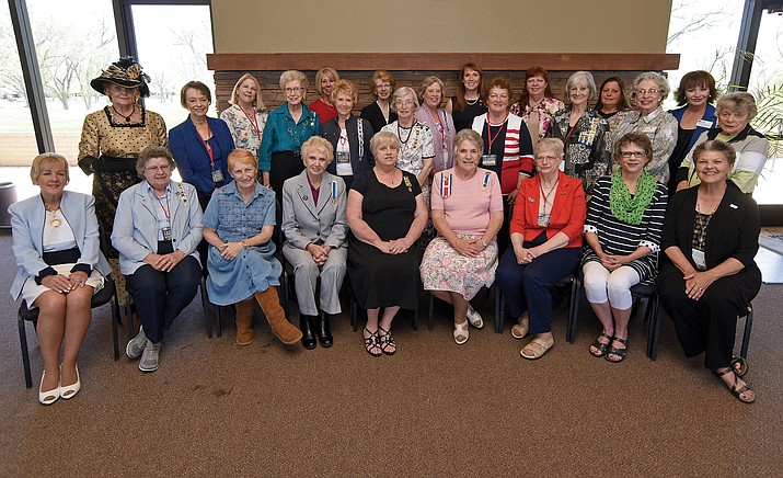 Members of the Daughters of the American Revolution Yavapai Chapter gather for a group photo during their 35th anniversary luncheon Wednesday afternoon April 20, 2016 at the Centennial Event Center in Prescott.