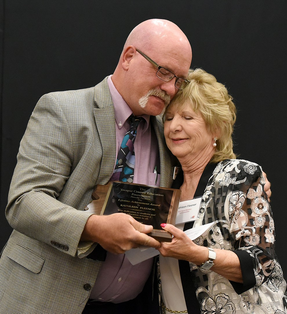 Kathleen Fleenor the 2016 Lifetime Achievement Award Recipient gets a hug from Yavapai County Education Foundation President Tim Wiederaenders while he presents her the award Friday night April 22, 2016 during the 22nd Annual Yavapai County Education Foundation's Teacher of the Year Award Ceremony and Banquet at the Prescott Resort. (Matt Hinshaw/The Daily Courier)