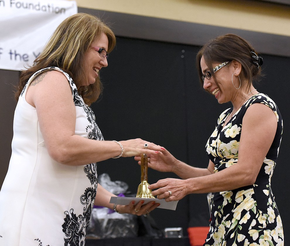 Cristina Brownfield a Del Rio Elementary School teacher accepts a Teacher of the Year Runner Up Award in the Cross-Grades Specialist K - 8th Category Friday night April 22, 2016 during the 22nd Annual Yavapai County Education Foundation's Teacher of the Year Award Ceremony and Banquet at the Prescott Resort. (Matt Hinshaw/The Daily Courier)
