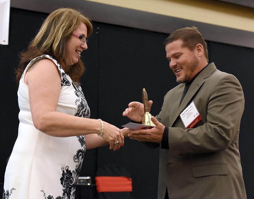 Allen Foster a Chino Valley High School teacher accepts a Teacher of the Year Runner Up Award in the Cross Grades Specialist 9 - 12th Grade Category Friday night April 22, 2016 during the 22nd Annual Yavapai County Education Foundation's Teacher of the Year Award Ceremony and Banquet at the Prescott Resort. (Matt Hinshaw/The Daily Courier)