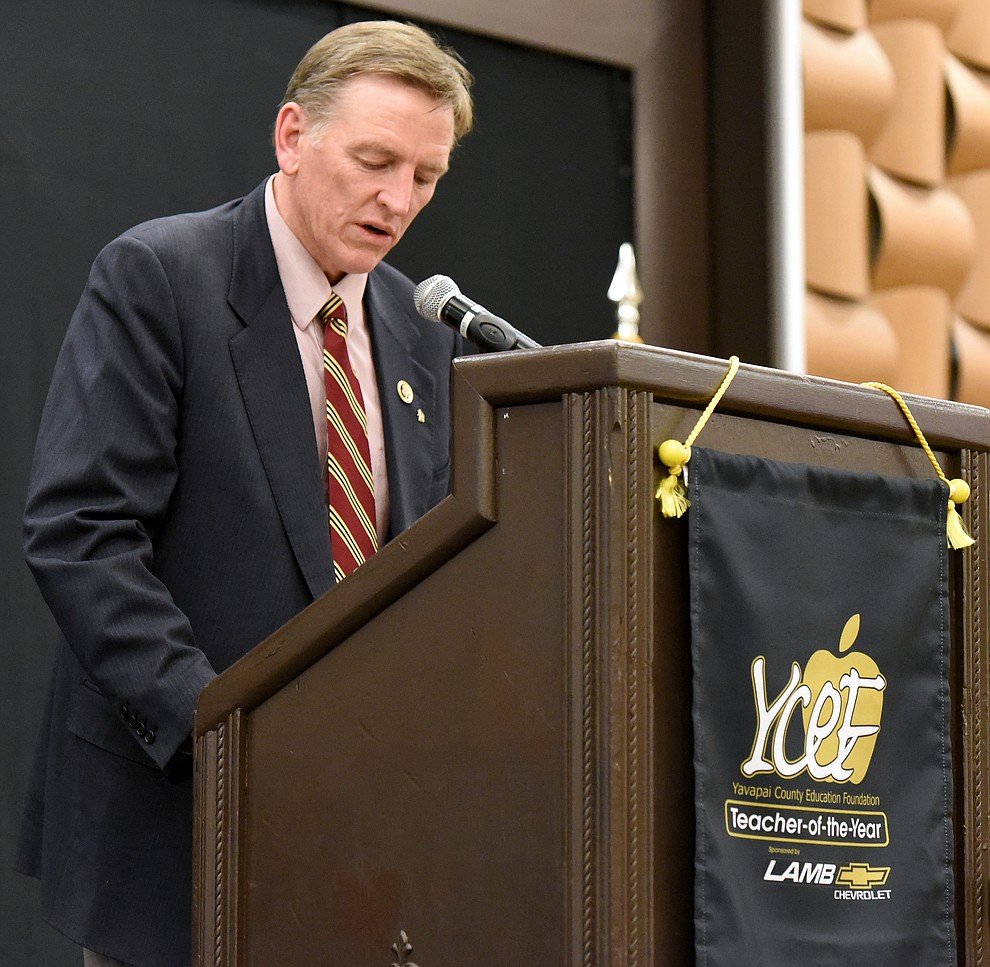 Congressman Paul Gosar talks about the 2016 Teacher of the Year winner Mike Westcott a Mingus Union High School chemistry teacher after winning the award Friday night April 22, 2016 at the Prescott Resort. (Matt Hinshaw/The Daily Courier)