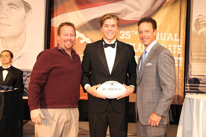 "Prescott High School football player Luke Roberts, middle, accepts a ""Top 60"" High School Football Scholar Athlete award for the class of 2016. The Valley of the Sun Chapter of the National Football Foundation recognized Roberts on April 2 (Photo Courtesy of Les Roberts)."