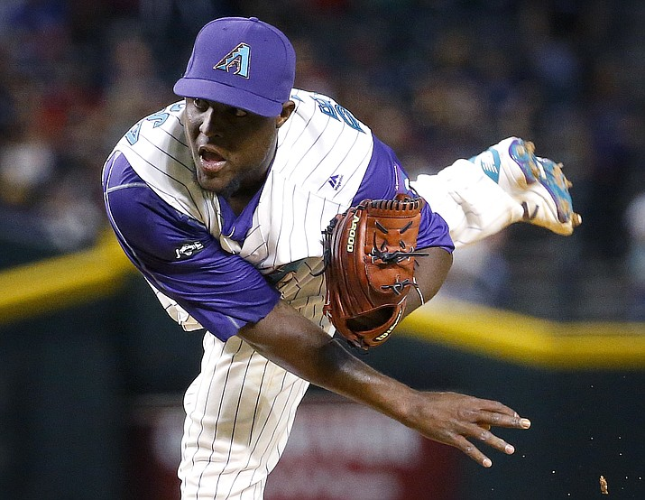 Arizona Diamondbacks starting pitcher Rubby De La Rosa (12) throws during the seventh inning of a baseball game against the St. Louis Cardinals, Thursday, April 28, in Phoenix.