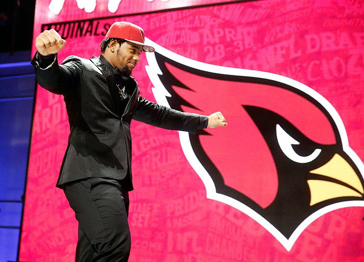 Mississippi's Robert Nkemdiche walks on the stage after the Arizona Cardinals selected him as the 29th pick in the 2016 NFL football draft Thursday, April 28, in Chicago.