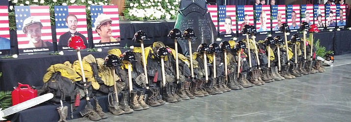 Turnout gear belonging to the Granite Mountain Hotshots is displayed at their memorial service at the Prescott Valley Event Center in July 2013.