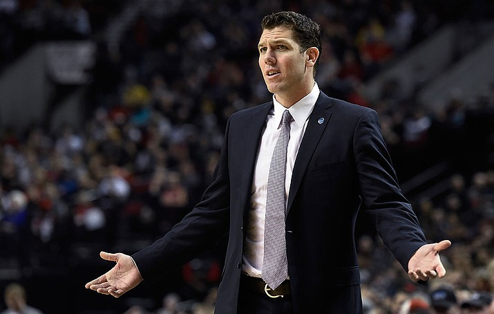 In this Jan. 8 file photo, Golden State Warriors assistant coach Luke Walton gestures during the first half against the Portland Trail Blazers. The Los Angeles Lakers have reached an agreement with Walton to become their next head coach.
