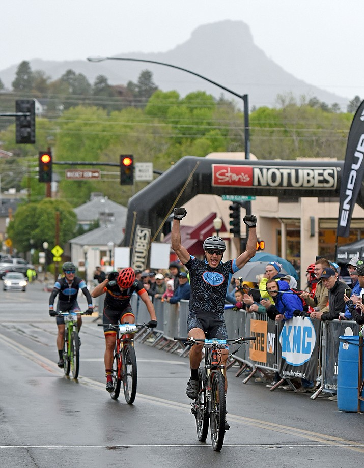 Whiskey Off-Road 50 Proof winner Joe Susco celebrates as he crosses the finish line after a sprint against Eric Salstrand, 2nd place, and Travis Waldron 3rd, Saturday afternoon April 30, 2016 during the 13th Annual Whiskey Off-Road in downtown Prescott. (Matt Hinshaw/The Daily Courier)