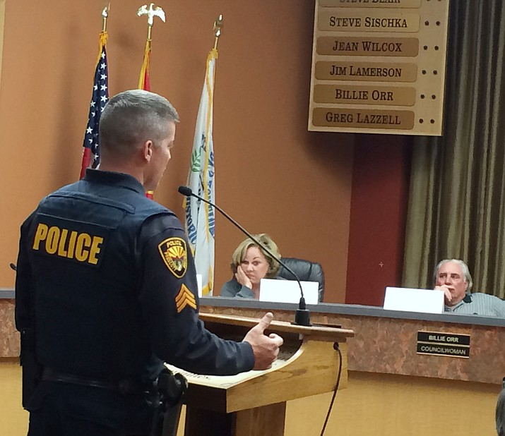 Brian Dever of the Prescott Police Department responds to questions from the Mayor's Ad Hoc Committee on Structured Sober Living Homes Wednesday, April 27, while committee members Lauren Newington, center, and Tom Montague, right, look on.