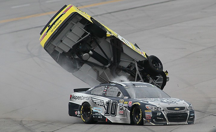Matt Kenseth's car flips after Danica Patrick (10) crashed into him during the NASCAR Talladega auto race at Talladega Superspeedway, Sunday, May 1.