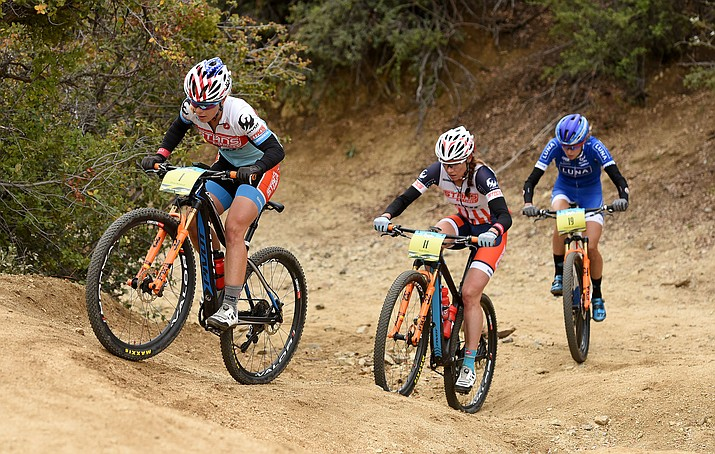 Chloe Woodruff, of Prescott, leads teammate Rose Grant, middle, and Rochette Maghalie through the course Sunday May 1, 2016 during the 13th Annual Whiskey Off-Road Pro Division in Prescott.  Grant won the race and her teammate Woodruff finished third.