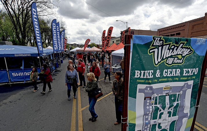 Residents and visitors check out the many vendors on Whiskey Row during the Whiskey Off-Road Gear and Bike Expo Saturday afternoon, April 30, in downtown Prescott.