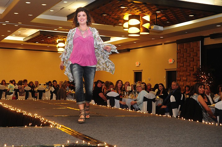 Danae Campbell models an outfit from Buckle at the 15th Annual Women's Council of Realtors Fashion Show Tuesday at the Prescott Resort.  (Les Stukenberg/The Daily Courier)