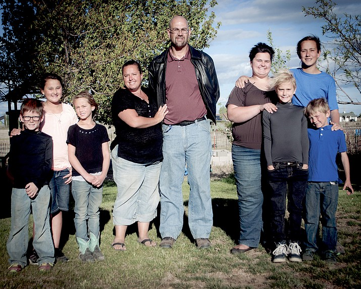 Kris Mazy-Fullmer with her family, (from left) Breckin (10), Elwyn (12), Rowan (8), Kris, Larry, Shelby (17), Griffin (14), Berlyn (10), Trystan (8). (Courtesy photo)