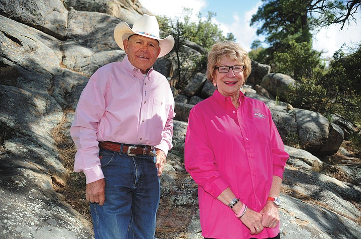 Prescott Frontier Days General Manager JC Trujillo and PFD Director Mary Ann Suttles wear their Tough Enough to Wear Pink shirts outside the rodeo office.