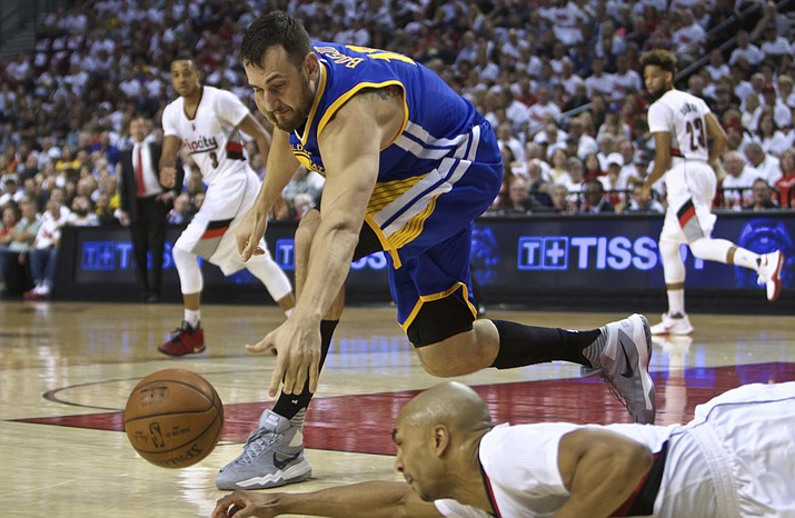 Golden State Warriors center Andrew Bogut, top, and Portland Trail Blazers guard Gerald Henderson dive for a loose ball during Game 4 Monday, May 9, in Portland, Ore.
