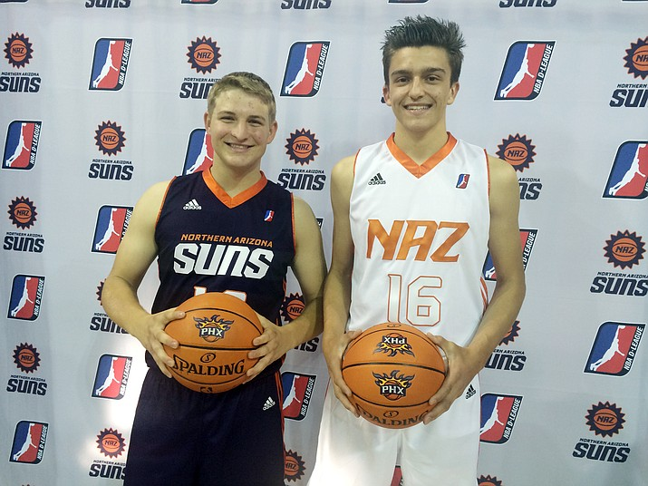 From left, Bradshaw Mountain High boys' basketball player Tim Young dons the Northern Arizona Suns' purple away uniform, while Prescott High boys' hoops player Tyler Bell wears the team's home whites Tuesday, May 10, at Prescott Valley Event Center.