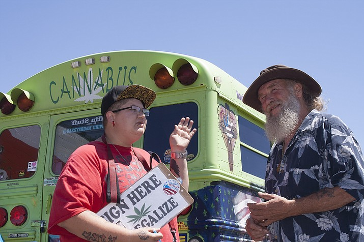 Dani Welch of Tucson talks with Jim Rhoda of Prescott Valley about Initiative 14. Welch and other campaign volunteers are in the greater Prescott area for a week of gathering signatures for an initiative that would legalize recreational marijuana in Arizona.