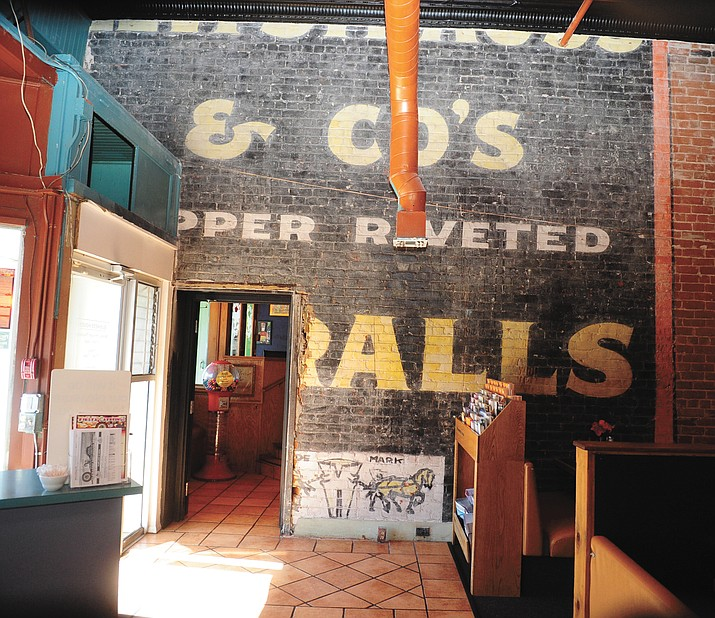 Gary Denning, owner of El Charro restaurant on Montezuma Street in Prescott, uncovered an old Levi Strauss wall advertisement while removing drywall in the restaurant.