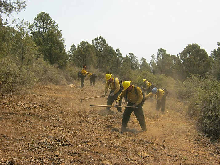 Yuma Hotshots dig a fire line in the forest. What kind of preparations can homeowners make ahead of wildfire season?